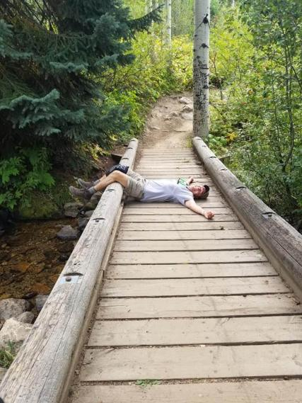 Michael taking a break on the wooden bridge