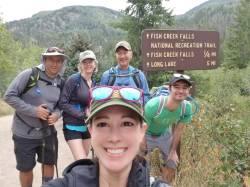 The gang at the Fish Creek Falls Trailhead sign.