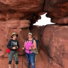 Janice and Karla in front of opening in rock formation
