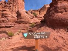 Sign pointing left for climbers of the pinnacle rocks and pointing right for hikers