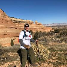 Michael standing on trail with Devil's Canyon in background