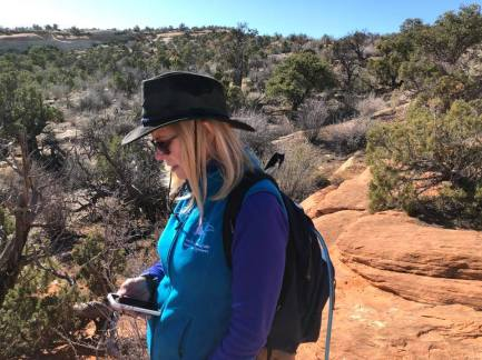 Linda checking her GPS