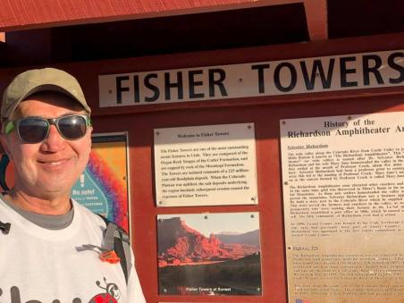 Michael standing in front of Fisher Towers Trailhead sign