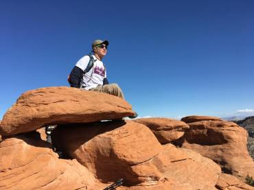 Michael sitting on top of hoodo
