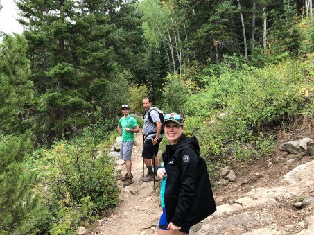 Bernie in the foreground and Zach and Mo in the background along the trail