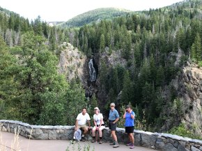 Mo, Bonnie, Janice and Marlys posing at the Fish Creek Falls overlook with the falls in the background