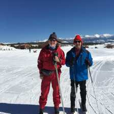 Einar and Michael standing on their skis on the snow-covered trail