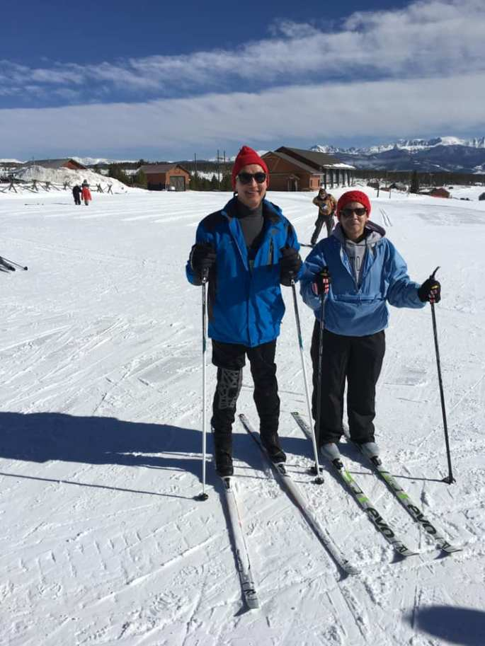 Michael and Cuqui standing in their skis after a mornings run on the trails