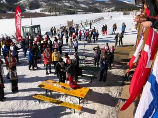 Skiers and guides outside the Nordic Center getting ready for the opening ceremonies