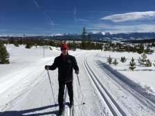 Michael standing in a set of tracks on the snow-covered trail