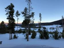 Sunset from the lodge and Sunset from the lodge - trees in the snow and mountains in the background- trees in the snow