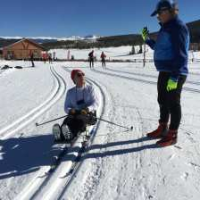 Michael in the sit ski and getting instuction on how to use the sit skin on