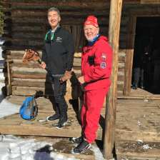 Closeup of Michael and Einar standing on porch of servant's quarters