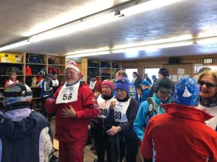 Einar along with other skiers and guides inside the Nordic Center getting ready for the opening ceremonies