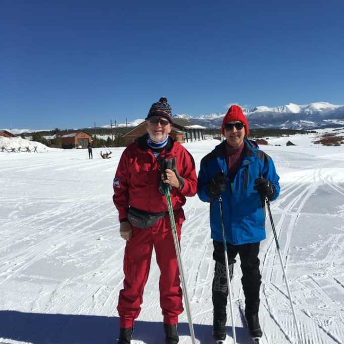 Einar and Michael standing on the snow with skis on