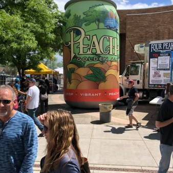 Giant 3D blowup of Peach Golden Ale can