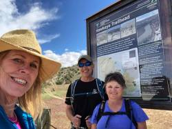 Linda, Marlys and Michael at the Hawkeye Trailhead sign