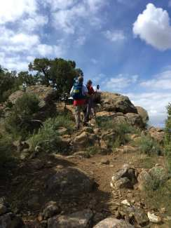 Janice leading Michael to the top of a secition of large boulders