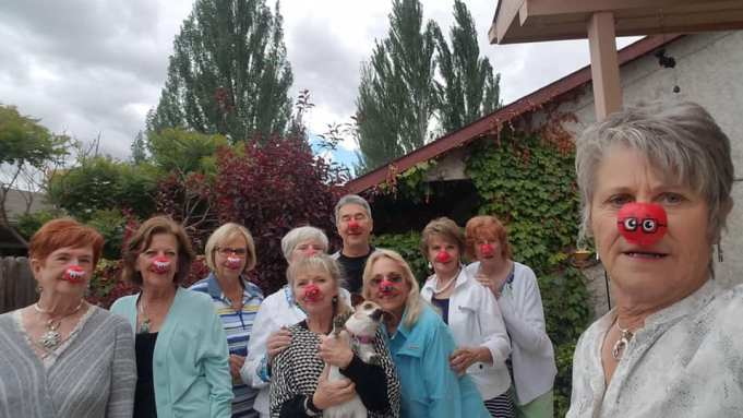 The whole group wearing red noses