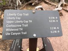 Trail marker sign show Liberty Cap, Corkscrew and other trails