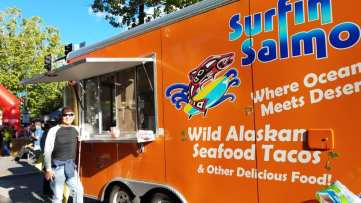 Michael ordering fish tacos at Surfing Salman food truck