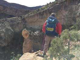 Janice guiding Michael throujgh some rocks along the trail