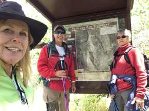 Linda, Michael and Janice standing in front of Palisades Rim Trailhead sign