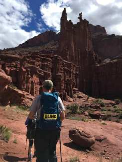 Michael from the back waling towards rock tower formations