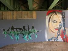 Painting of headshot of blond woman with the name Katrina next to it