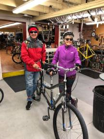 Michael and Janice standing next to tandem bike at Brown Cycle Shop