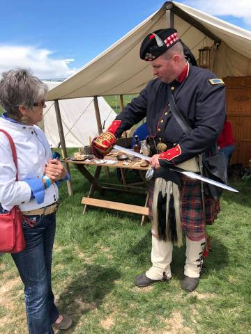 Guardsman showing Janice his sword