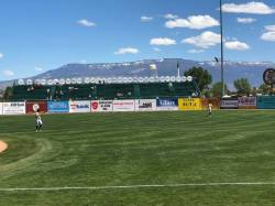 Left field with Grand Mesa mountains in the background