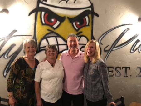 Janice, Marlys, Michael and Linda standing in front of Feisty Pint sign