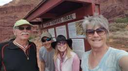 Eric, Michael, Linda and Janice standing in front of Fisher Towers Trailhead sign