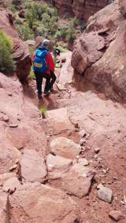 Linda guiding Michael down steep rocky section of the trail