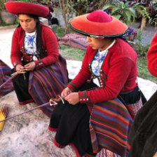 Women in native costumes demonstrating hand weaving at Chinchero