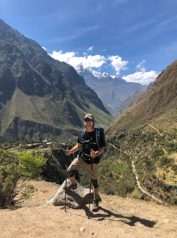 Michael standing at overlook of the Urubamba River valley