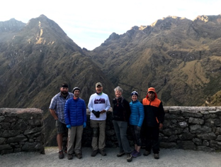 The team standing at spectacular overlook at ruins of Runkuracay
