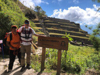 Juan Carlos and Michael standing next to Sayacmarca ruins sign